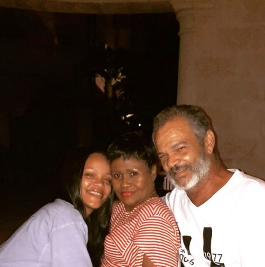 Makeup-free Rihanna hangs out with her parents in lovely new photos