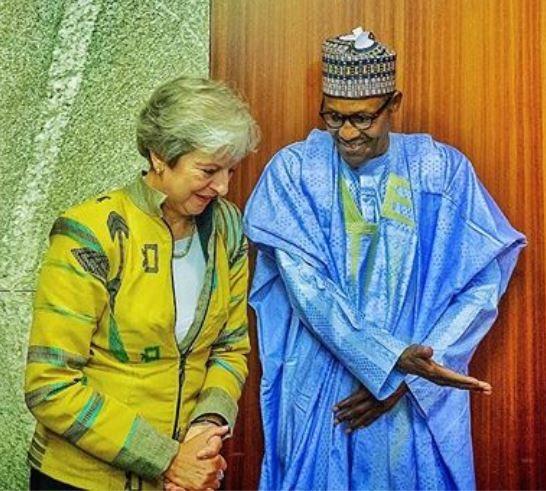 Caption this photo of President Buhari and British Prime Minister, Theresa May