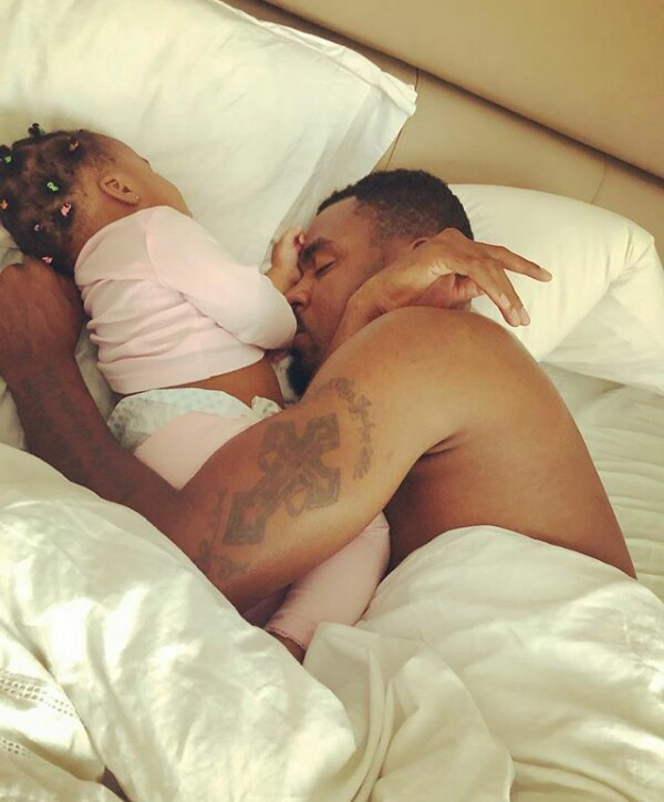 Adorable photo of Emmanuel Emenike cuddled up in bed with his daughter as they sleep