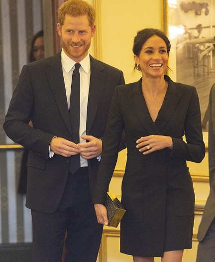 Meghan Markle displays long legs in mini Tuxedo dress as she and Prince Harry attend a gala performance in support of Sentebale