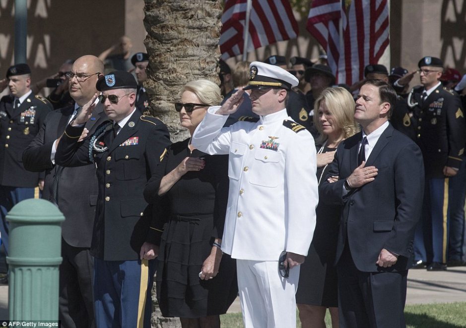John McCain's wife kisses his casket while his daughter cries over it at his memorial service (Photos)