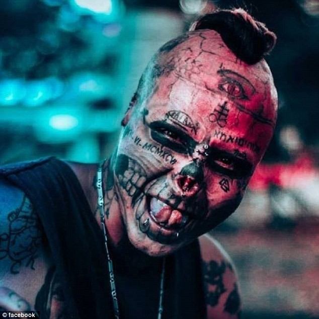22-year-old man has half his nose cut off, ears mutilated and eyes tattooed to look like this ?(Horrific Photos)