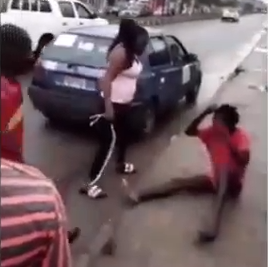 Mentally unstable man beaten after he was caught picking used condoms and sanitary pads in Port Harcourt (video)