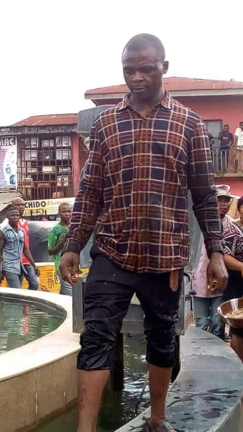 Photos: Man arrested after he pulled down Dr. Akanu Ibiam statue in Ebonyi, claims he was sent by the Holy Spirit