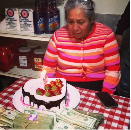 Rapper 6ix9ine's mom gets emotional after he surprises her with tons of cash on her Birthday (Video)