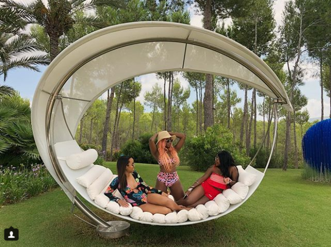 DJ Cuppy shows her bikini body as she holidays with her best friends in Ibiza (Photos)