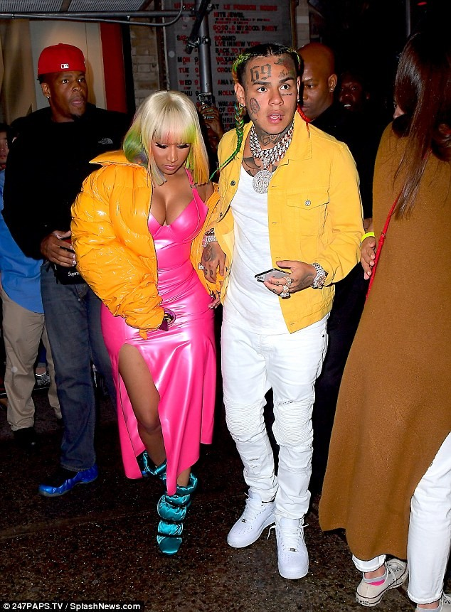 Nicki Minaj and rapper Tekashi 6ix9ine step out in colourful outfits as they hit fashion show together (Photos)