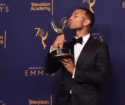 John Legend becomes the first black man and youngest person to win?an Emmy, Grammy, Oscar and a Tony Award?