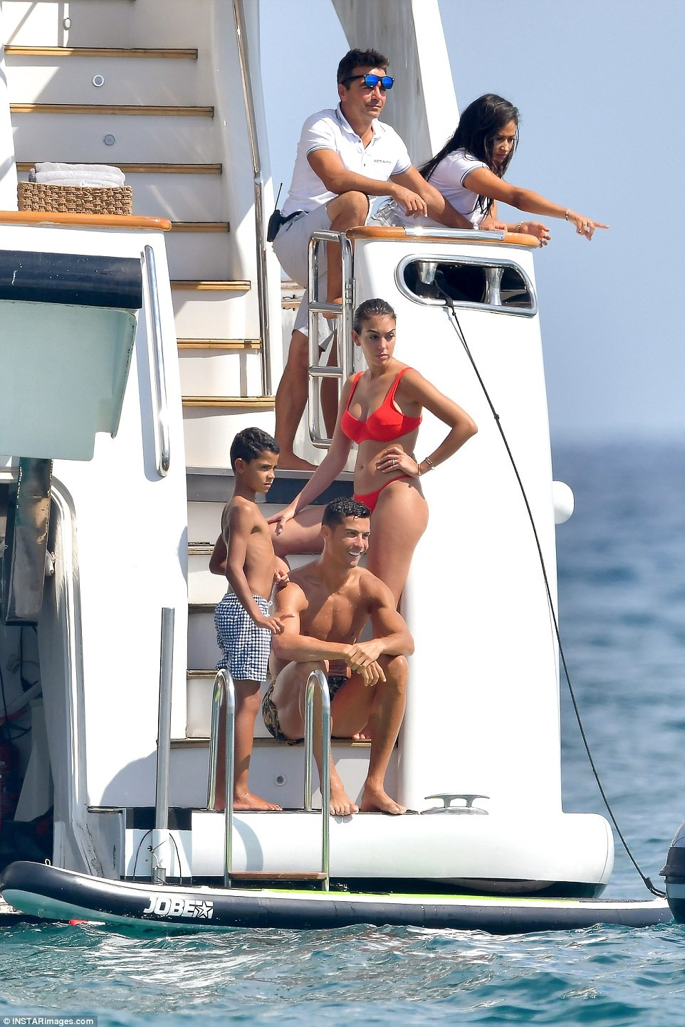 Ronaldo soaks up in Saint Tropez with his bikini-clad partner Georgina Rodriguez and son Cristiano Jr (Photos)