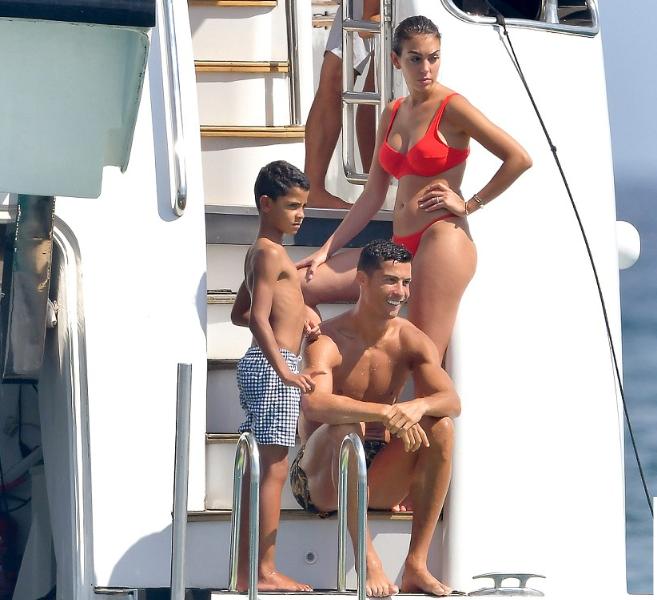 Ronaldo soaks up in Saint Tropez with his bikini-clad partner Georgina Rodriguez and son Cristiano Jr (Photos)