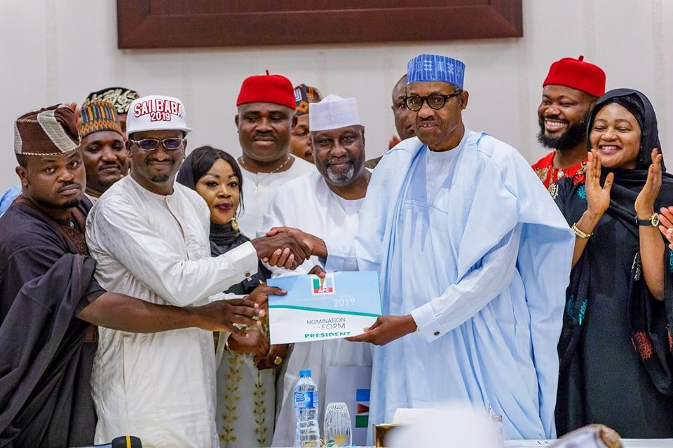 Photos: President Buhari receives APC nomination form purchased by a support group