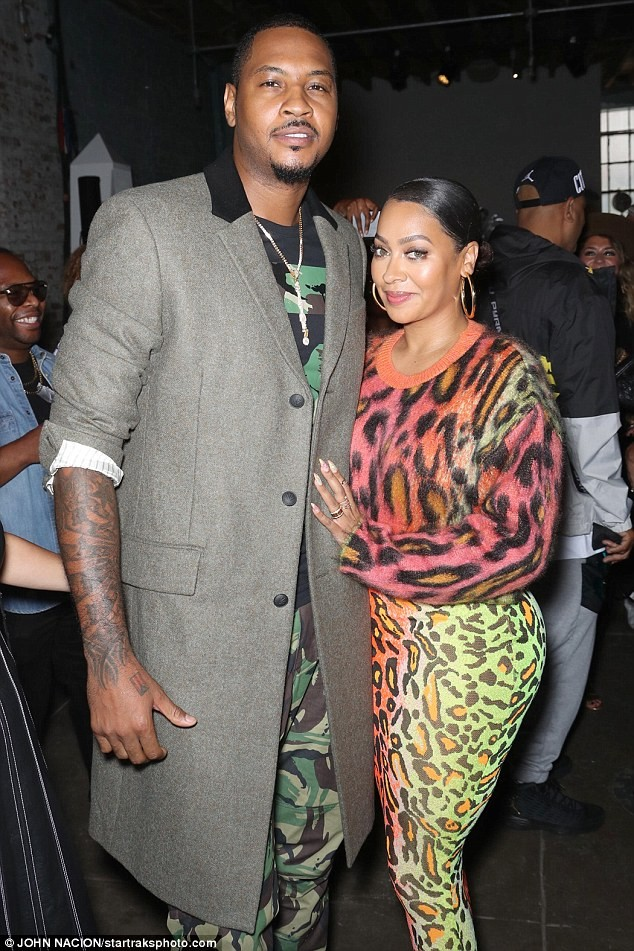 La La Anthony appears to be back with husband Carmelo Anthony as they pose together at his NYFW show (Photos)