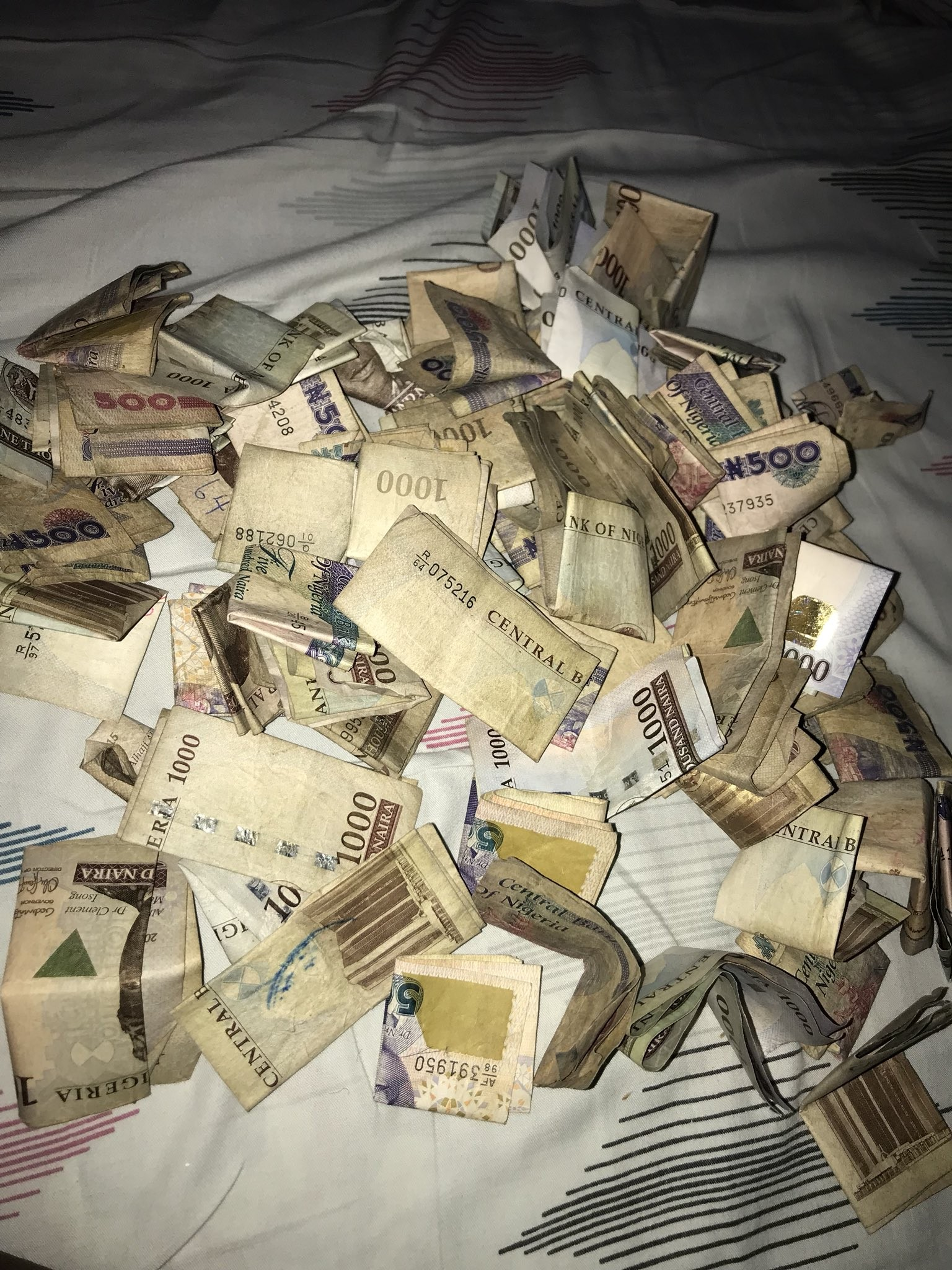 See the amount of money this lady realised after she broke her savings box (photo)