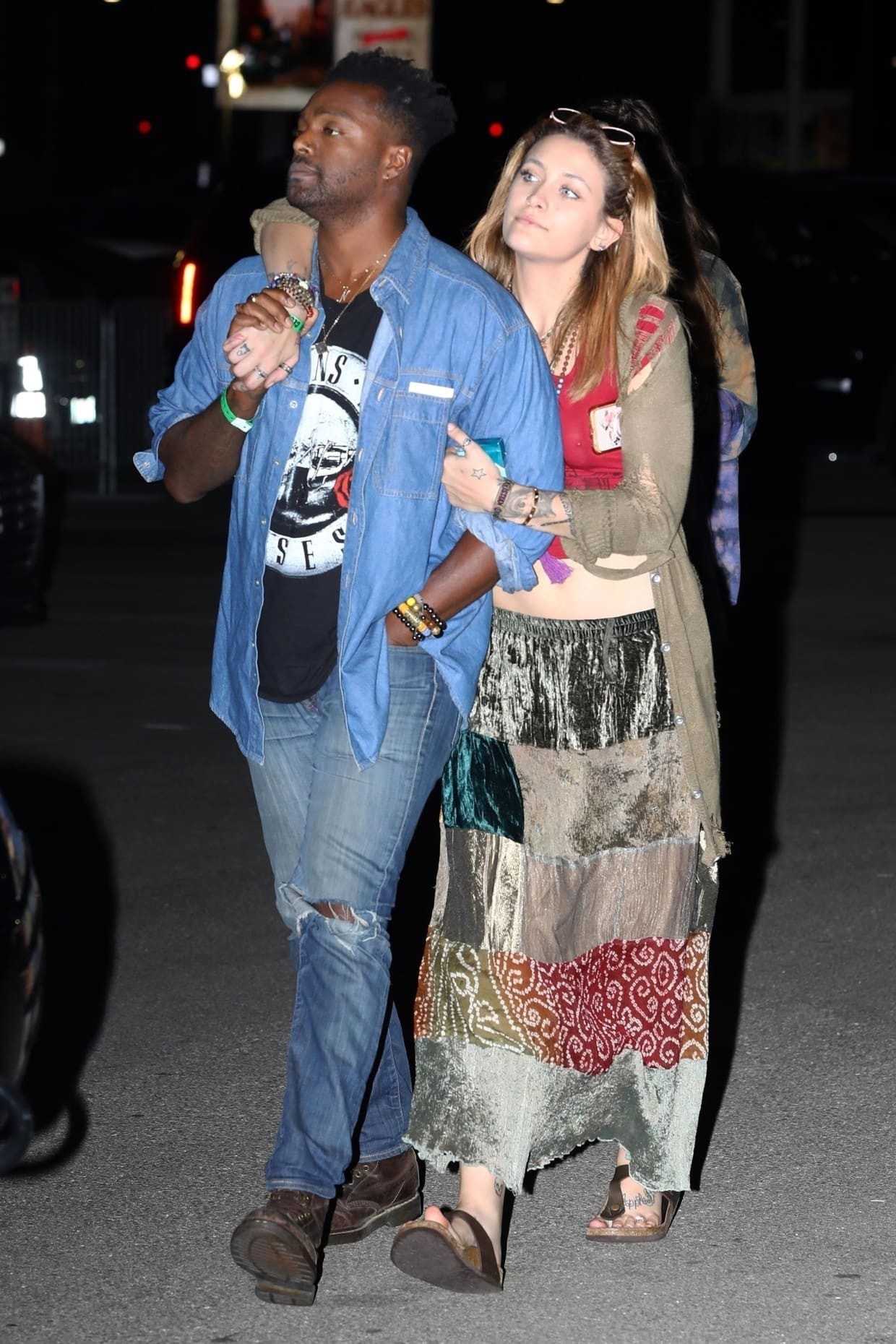 No longer a lesbian? Paris Jackson pictured out with rumoured new love interest...a black man! (photos)