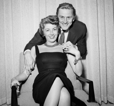 Photos-Spartacus actor Kirk Douglas, 101, and wife Anne Buydens, 99, remain inseparable after 64 years of marriage as they are pushed along in wheelchairs