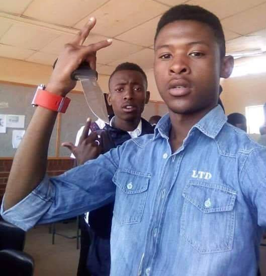 Photo of 17-year-old student brandishing a knife before stabbing teacher to death (graphic photos)