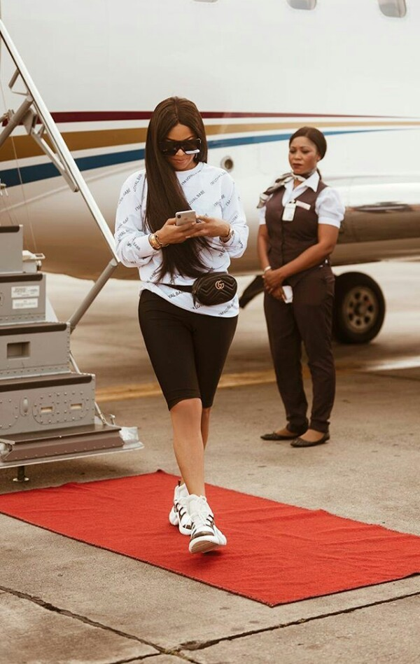 Air hostess pictured checking out Toke Makinwa