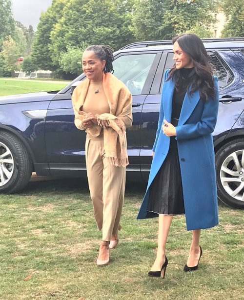 Meghan Markle pictured with her mum and her husband Prince Harry as she launches new charity cookbook at Kensington Palace