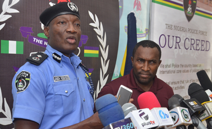 Photos: Police parade suspect who threatened to rape, kill Atiku?s wife, daughters  over 2019 presidential election