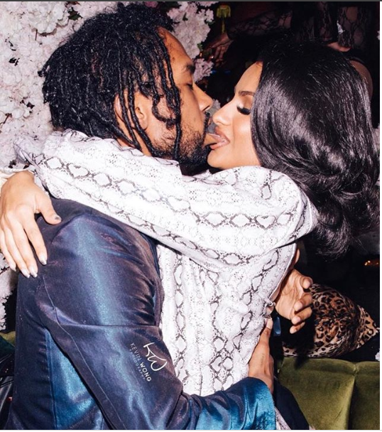 Singer Miguel and his fianc?e Nazanin Mandi share a tongue biting kiss in new loved-up photo.