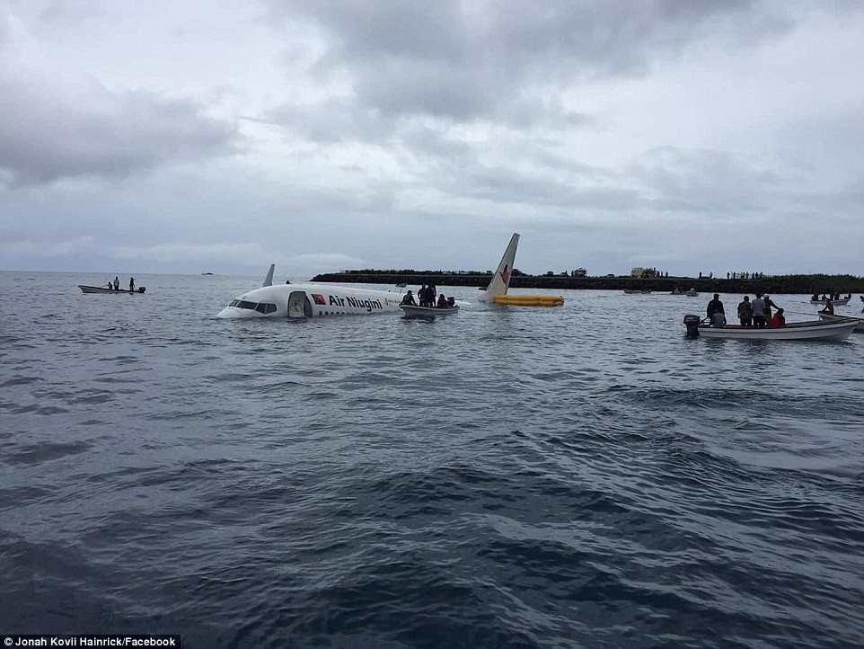 Photos/Video-Plane overshoots a runway in Micronesia and crash lands in the ocean..but all 47 passengers and crew miraculously survive