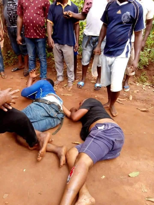 Men stripped naked and beaten after allegedly being caught stealing from a shrine (photos)