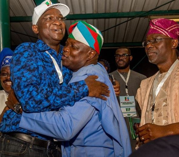Photo of Governor Ambode hugging his predecessor, Babatunde Fashola