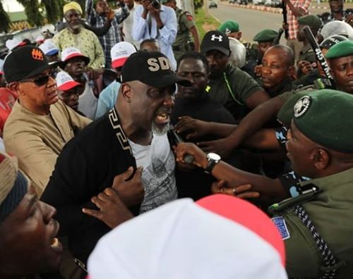 PDP protest: Senator Dino Melaye and Ben?Bruce to report to FCT Police Command tomorrow