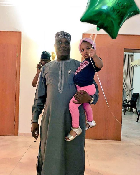 Atiku Abubakar shares cute photo with his granddaughter as he returns home after winning PDP presidential ticket