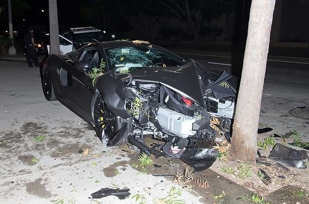Photos-Actor Terrence J and his model girlfriend Golden Barbie 'smash $200k McLaren sports car into a tree before fleeing the scene'