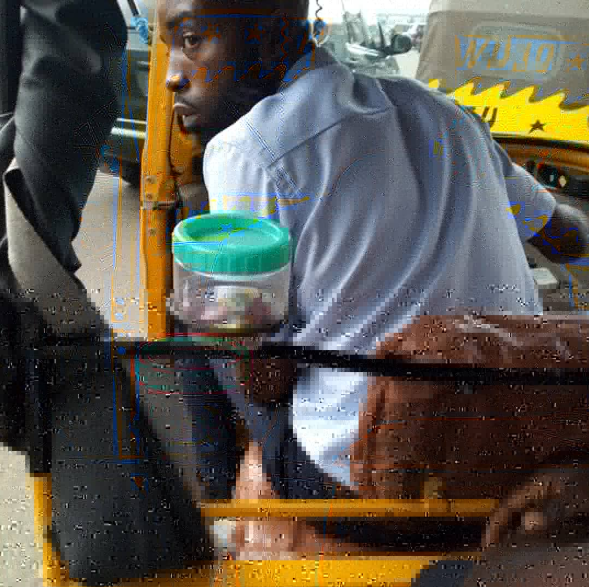 """Corporate keke driver"" who has sweets and his business card in his tricycle for passengers goes viral (photos)"