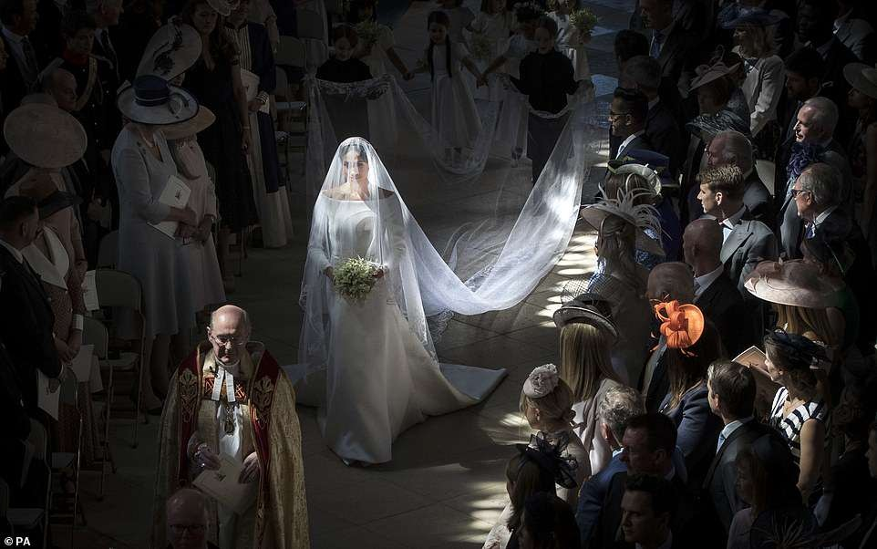 Stunning shot of Meghan Markle as she walks down the aislel is crowned best royal photo of the year
