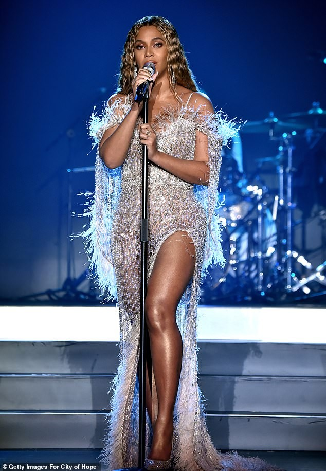 Flawless photos of Beyonc? in dazzling feathered gown as she performs at Hope Gala in Santa Monica