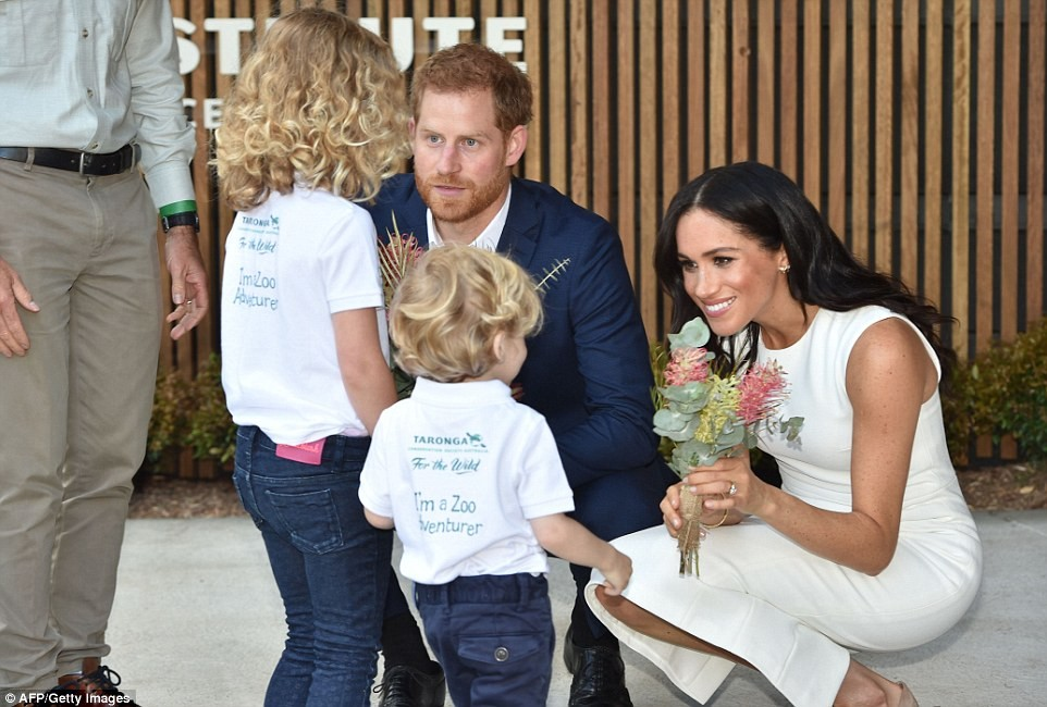 Never been happier! Delighted Meghan and Harry step out on the first official engagement of their tour to Australia