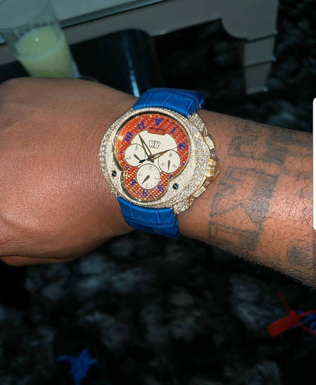 Davido shows off diamond encrusted wristwatch as he flies on a private jet with girlfriend Chio