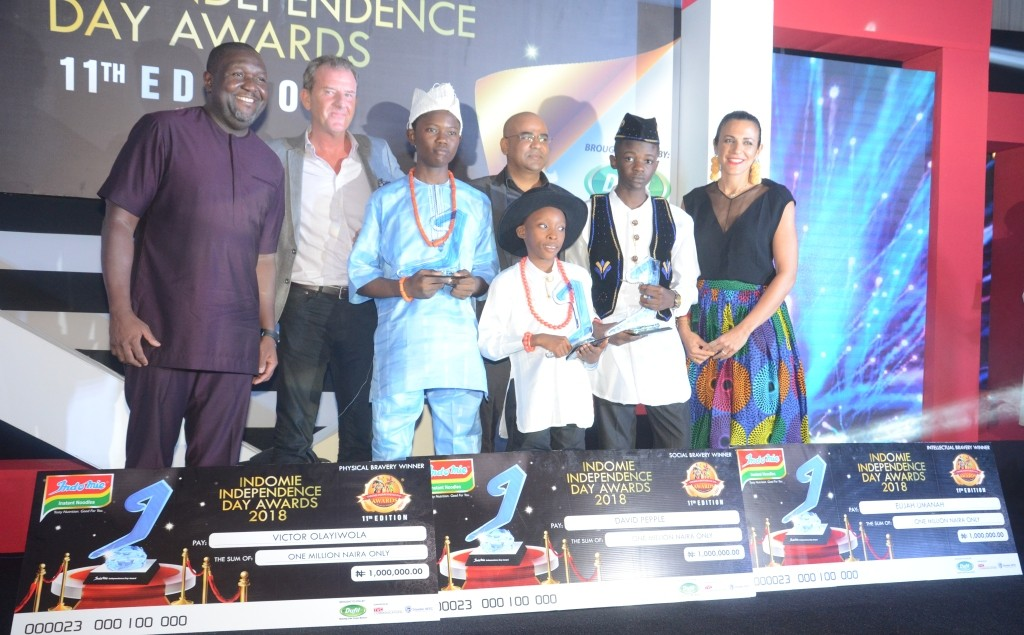 Boy who lost leg while saving mum, others win multi-million scholarships at Indomie award