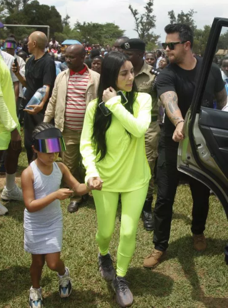 Kanye West hands out Yeezys to children as he and Kim Kardashian continue their tour of Uganda (photos/video)