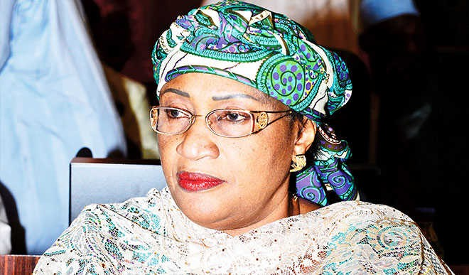 Weeks after her defection, Aisha Alhassn storms APC headquarters to retrieve rugs, computer, chairs she donated to the party