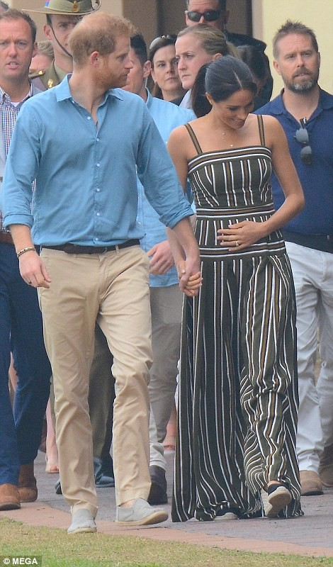 Meghan cradled her baby bump in a maxi dress for trip to Bondhi beach after which she changed into a lovely gown to visit school children (photos)