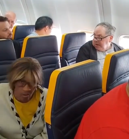 Racist passenger hurls insult at Black woman and refuses to let her sit next to him on Ryanair flight (video)