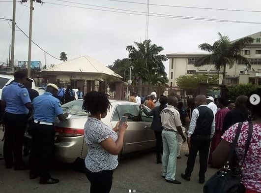Chaos at  NHIS headoffice as suspended executive secretary force his way into the office while police teargas protesting workers(photos)