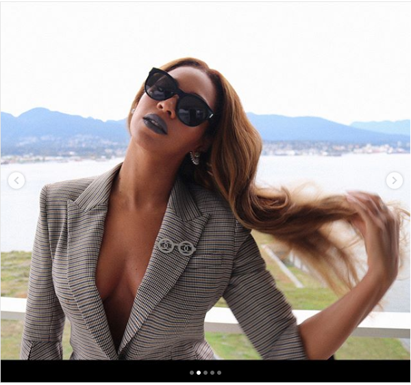 Beyonce flaunts her cleavage in stylish vintage suit (Photos)