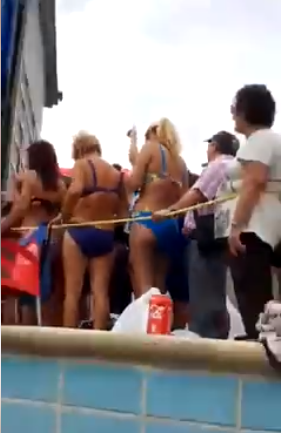 Man left with an erection while standing behind a bikini clad woman (video)