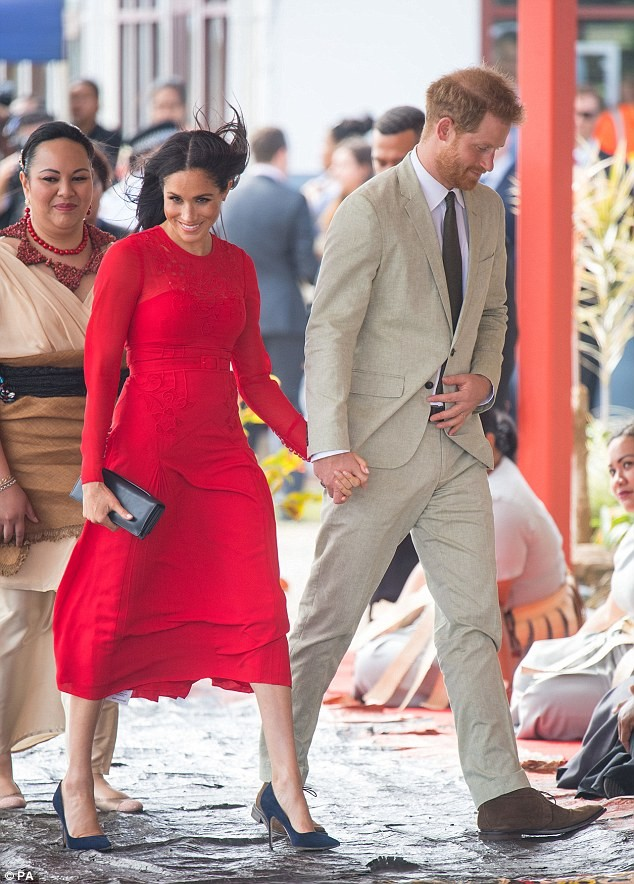 Meghan Markle stuns in three different outfits in one day, including a red frock specially tailored for her baby bump ?(Photos)