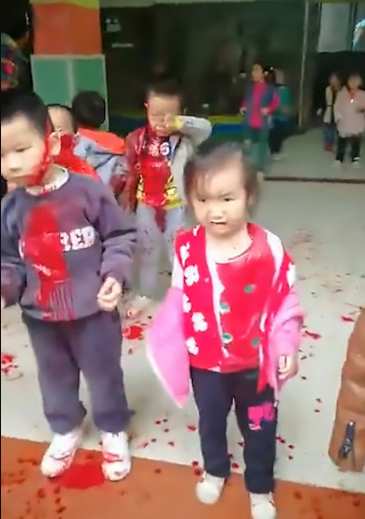 Woman armed with kitchen knife storms kindergarten and slashes 14 children (distressing footage)