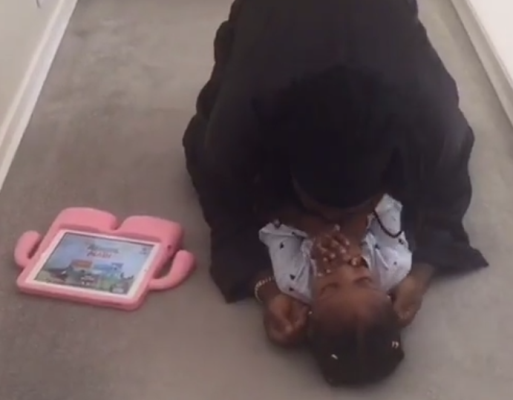 Timaya gives his daughter a thousand kisses in adorable video