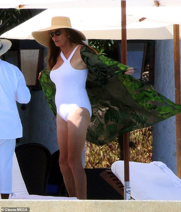 Caitlyn Jenner dons white swimsuit as she celebrates 69th birthday with her rumored transgender beau Sophia Hutchins