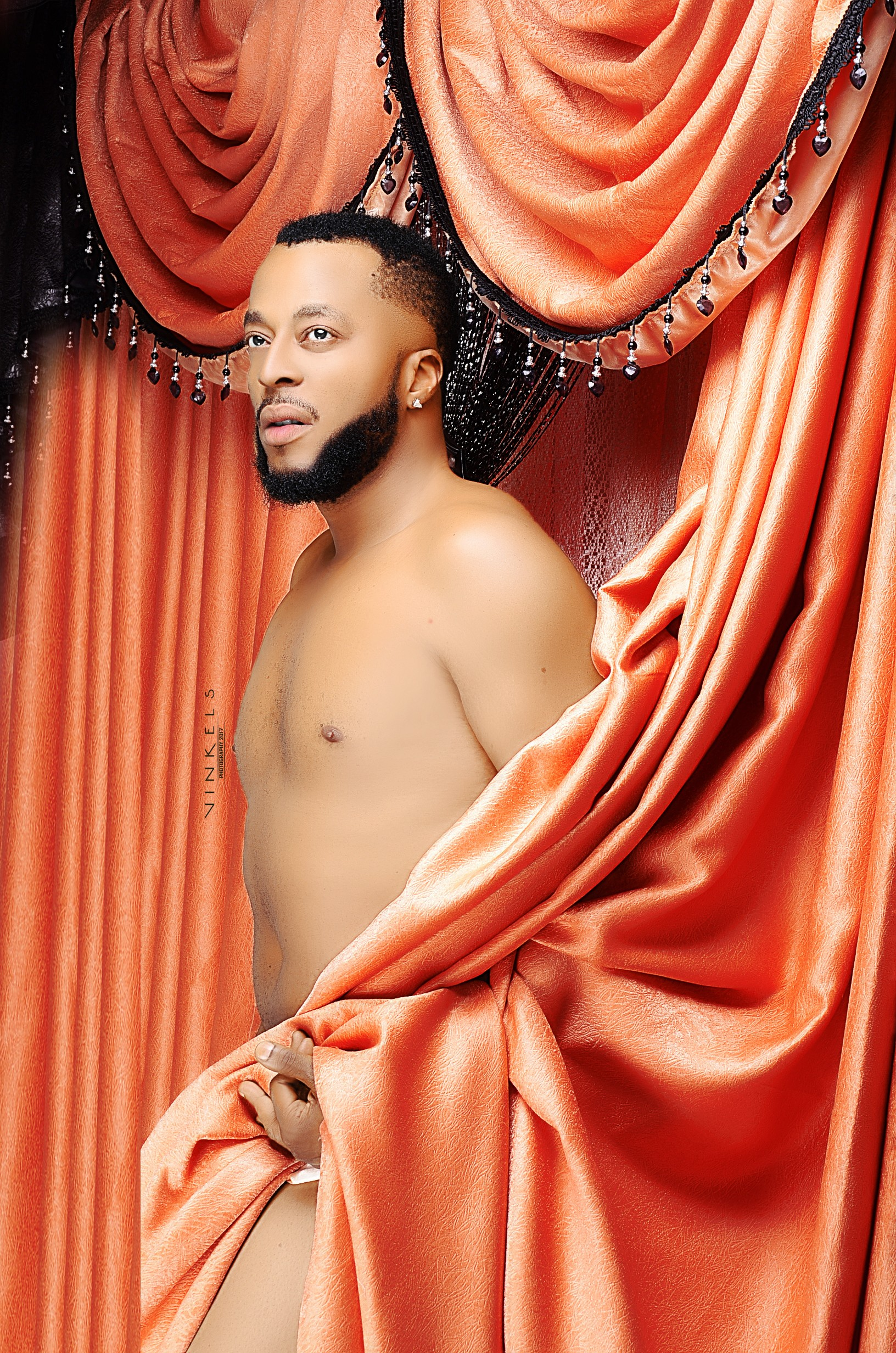 Actor Benson Okonkwo releases semi-nude photos