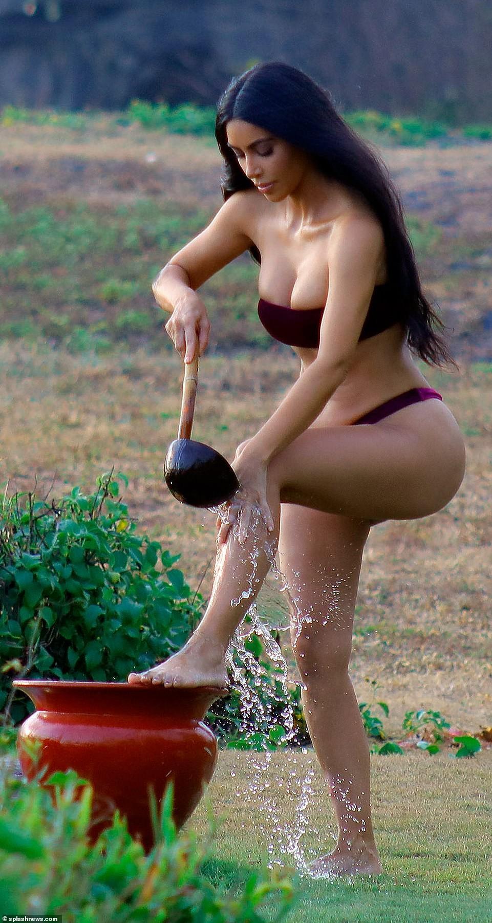 Bikini-clad Kim Kardashian flaunts her eye-popping figure in new photoshoot (Photos)