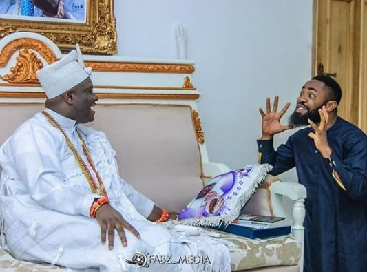 Caption this photo of Ooni of Ife and Comedian, Arole